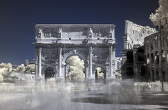 Rome, Italy, infrared Arch of Constantine. Infrared, false colour, long exposure, detail of Arch of Constantine with partial view of Colosseum (coliseum), Rome Stock Image