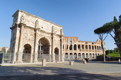 ROME, ITALY - JANUARY 21, 2010: Colosseum and Arch of Constantin. E in Rome, Italy. Colloseum of the largest amphitheatre in the world and the arch of Stock Image