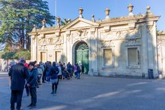 People waiting to get a view of Saint Peter`s Basilica through the keyhole of the door leading to the Villa del Priorato di Malta. ROME, ITALY - JANUARY 1, 2017 Stock Image