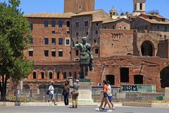 Tourists and bronze statue of Emperor Trajan, Rome, Italy. royalty free stock images