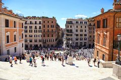 Tourists on the Spanish Steps, Rome, Italy. ROME, ITALY - JULY 16, 2017: Tourists in Piazza di Spagna, on the Spanish StepsScalinata di Trinita dei Monti, Rome royalty free stock images