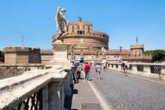 Ponte Sant Angelo in Rome with the imposing Castel Sant Angelo on the background Stock Photos