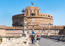 Ponte Sant Angelo in Rome with the imposing Castel Sant Angelo on the background Royalty Free Stock Photos