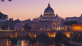 ROME, ITALY - 18 JUN, 2019 - Timelapse of Saint Peter cathedral, bridge Saint Angel and Tiber river in dusk in 4k. View of Ponte Sant Angelo with St. Peter`s stock footage