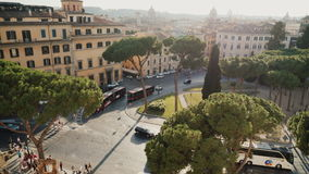 Rome, Italy, June 2017: Aerial view: Traffic, Cars and buses at Piazza Venezia. Piazza Venezia is the central hub of stock footage