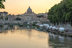 Amazing Sunset view of Tiber River, St. Angelo Bridge and St. Peter`s Basilica in Rome, Italy Royalty Free Stock Photo
