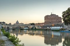 Amazing Sunset view of Tiber River, St. Angelo Bridge and St. Peter`s Basilica in Rome, Italy Royalty Free Stock Image