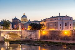 Amazing Sunset view of Tiber River and St. Peter`s Basilica from St. Angelo Bridge in Rome, Italy Stock Images
