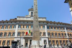 ROME, ITALY - JUNE 23, 2017: Amazing view of Palazzo Montecitorio and Obelisk of Montecitorio in city of Rome. Italy Royalty Free Stock Photography