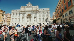Rome, Italy - June, 2017: A crowd of tourists walk around the Trevi Fountain in Rome. Popular place among tourists from. The famous Trevi Fountain in Rome stock video