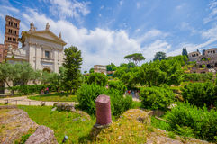 ROME, ITALY - JUNE 13, 2015: Inside Roman Forum, nice little ancient city and  big temple in the middle Royalty Free Stock Photos