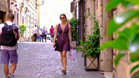 Rome, Italy 28 June 2018 street life with tourists walking and green nature alley 4k video stock video