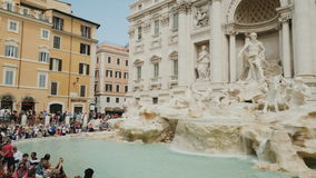 Rome, Italy - June, 2017: The A lot of visitors admire the famous Trevi Fountain in the center of Rome. Wide angle pan. The famous Trevi Fountain in Rome stock video footage