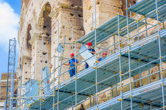ROME, ITALY - JUNE 13, 2015: Mens working outside Roman Coliseum, reconstruction hand works Royalty Free Stock Images