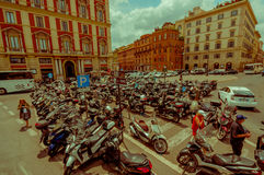 ROME, ITALY - JUNE 13, 2015: Motorcycle parking place near Rome center, people walking around. Scooters Royalty Free Stock Photography