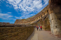 ROME, ITALY - JUNE 13, 2015: People inside Roman Coliseum visiting and learning italian heritage Royalty Free Stock Photography