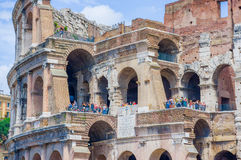 ROME, ITALY - JUNE 13, 2015: People visiting Roman Coliseum and taking photos from outside, sunny day and blue sky.  Stock Images