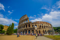 ROME, ITALY - JUNE 13, 2015: Roman coliseum view from outside, turists walking and visiting this iconic structure stock photo