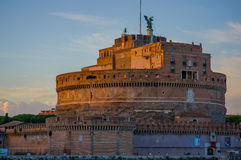 ROME, ITALY - JUNE 13, 2015: Saint Angelo castle in the center of Rome, an angel in the top and Italian flag on the side Stock Photography