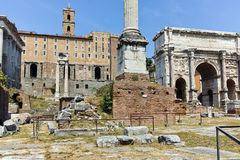 ROME, ITALY - JUNE 24, 2017: Septimius Severus Arch and Capitoline hill in Roman Forum in city of Rome Royalty Free Stock Image