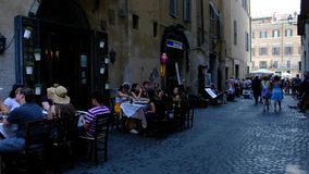 Rome, Italy 28 June 2018 street life with people enjoying a meal 4k video stock video footage
