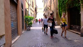Rome, Italy 28 June 2018 street life with tourists walking and green nature alley 4k video stock footage