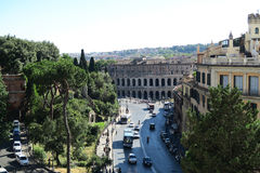 Rome Italy 18 June 2016. Theater of Marcellus view from Capitol Hill. The street named by the theater Via del Teatro di Marcello with tourists, traffic and royalty free stock photos