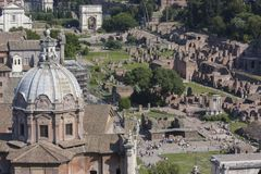 Rome, Italy - June 2, 2012: Top view of the Fori Imperiali with. Rome, Italy - 2 June 2012: Top view of the Fori Imperiali with tourists intent on visiting to royalty free stock images