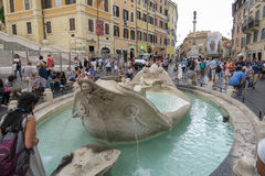 Rome, Italy June 17 2016. Tourists at Fontana della Barcaccia Piazza Di Spagna. The fountain of the ugly boat has been restored in 2014. The Spanish Steps stock photos