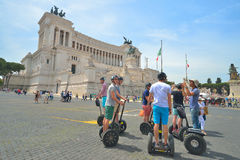 Rome, ITALY - JUNE 01: Tourists on segway in Piazza Venezia and Victor Emmanuel II Monument in Rome, Italy on June 01, 2016 Stock Photo