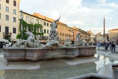 Tourists are strolling at the sunset in a Piazza Navona in city of Rome, Italy Royalty Free Stock Photography