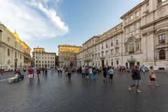 Tourists are strolling at the sunset in a Piazza Navona in city of Rome, Italy Stock Image