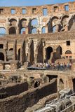 Tourists visiting inside part of  Colosseum in city of Rome, Italy. ROME, ITALY - JUNE 24, 2017: Tourists visiting inside part of  Colosseum in city of Rome Royalty Free Stock Photography