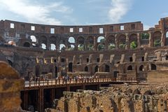 Tourists visiting inside part of  Colosseum in city of Rome, Italy. ROME, ITALY - JUNE 24, 2017: Tourists visiting inside part of  Colosseum in city of Rome Royalty Free Stock Photo