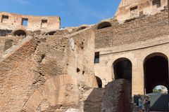 Tourists visiting inside part of  Colosseum in city of Rome, Italy. ROME, ITALY - JUNE 24, 2017: Tourists visiting inside part of  Colosseum in city of Rome Stock Images