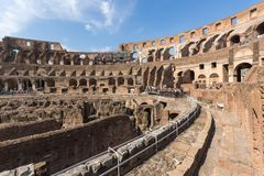 Tourists visiting inside part of  Colosseum in city of Rome, Italy. ROME, ITALY - JUNE 24, 2017: Tourists visiting inside part of  Colosseum in city of Rome Royalty Free Stock Images