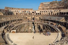 Tourists visiting inside part of Colosseum in city of Rome, Italy. ROME, ITALY - JUNE 24, 2017: Tourists visiting inside part of  Colosseum in city of Rome Royalty Free Stock Photos