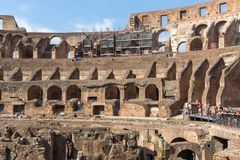 Tourists visiting inside part of  Colosseum in city of Rome, Italy. ROME, ITALY - JUNE 24, 2017: Tourists visiting inside part of  Colosseum in city of Rome Stock Photos