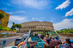 ROME, ITALY - JUNE 13, 2015: Turists bus visiting the most important places in Rome city, people watching from their Stock Photo