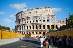 View of the Colosseum, with tourists, Rome, Italy. ROME, ITALY - 29 JUNE 2018: View of the Colosseum, with tourists going to visit it, with the barriers that Royalty Free Stock Photos
