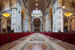Rome, Italy - March 1, 2013: The Basilica of St. Peter in the Vatican is the largest of the four papal basilicas of Rome, often de Stock Photography