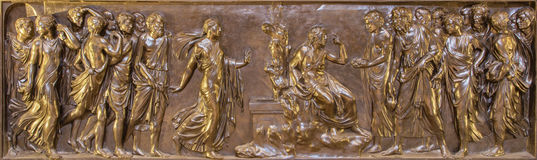 ROME, ITALY - MARCH 9, 2016: The bronze relief Christ and the Samaritan Stock Photos