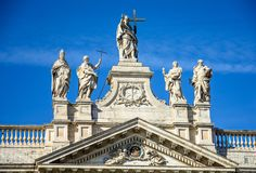 Fragment of the balustrade of the Cathedral of St. John the Baptist on the Lateran Hill in Rome royalty free stock photography