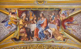 ROME, ITALY - MARCH 9, 2016: The detail of vault fresco Mary Washes Jesus's Feet in church Chiesa di Santa Maria Maddalena Stock Image