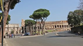 ROME, ITALY - March 25, 2017: Road traffic on the background of the arch of Constantine in Rome. stock video footage