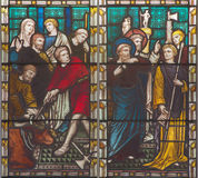 ROME, ITALY - MARCH 9. 2016: The scene St. Paul against the pagan offertory of animals on the stained glass of All Saints` Anglica Stock Image