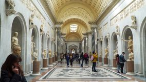 Tourists view statues in the Vatican Museums. Rome, Italy - March 21, 2018: Tourists view statues in the Vatican Museums stock footage