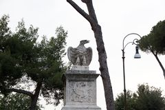 Rome, Italy - May 29, 2018: eagle statue in Villa Borghese Park. Decorations and monuments of Borghese Park in Rome, Italy. Eagle statue in Villa Borghese Park royalty free stock photography