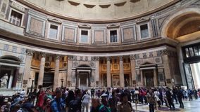 Rome, Italy - May 05, 2016: Pantheon interior. Many tourist in the old Roman temple and view of dome with light hole in stock video footage