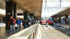 Passengers getting off from train at Termini Railway Station Rome Italy. Rome, Italy - May 2018: Passengers getting off from train at Termini Railway Station stock footage